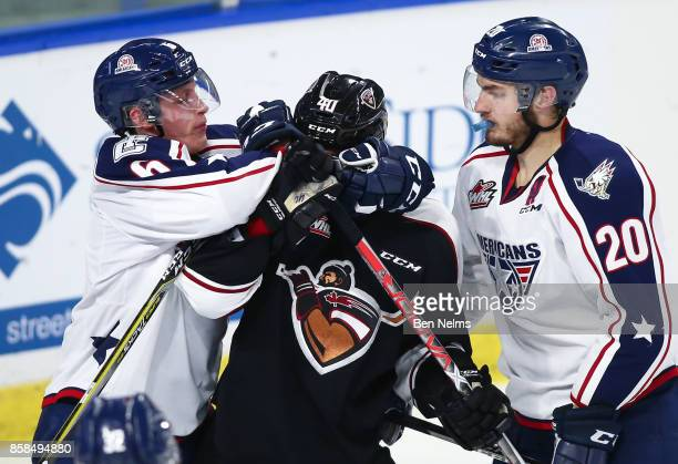 Milos Roman of the Vancouver Giants is grabbed by Juuso Valimaki of the TriCity Americans during the second period of their WHL game at the Langley...