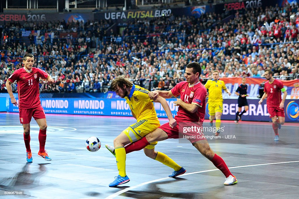 Milos Simic of Serbia, Volodymyr Razuvanov of Ukraine and Slobodan Rajcevic of Serbia in action during the UEFA Futsal EURO 2016 quarter final match between Serbia and Ukraine at Arena Belgrade on February 8, 2016 in Belgrade, Serbia.
