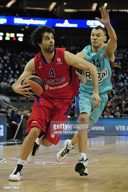 Milos Teodosic of CSKA Moscow tussles with Sarunas Jasikevicius of FC Barcelona Regal during the Turkish Airlines EuroLeague Final Four third place...
