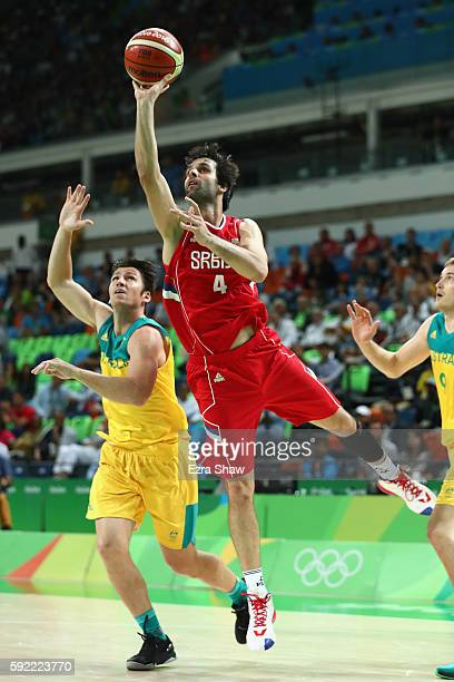 Milos Teodosic of Serbia attempts a shot against Australia during the Men's Semifinal match on Day 14 of the Rio 2016 Olympic Games at Carioca Arena...