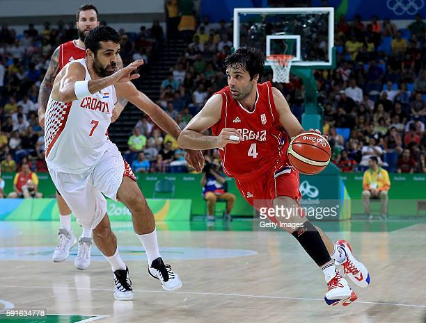 Milos Teodosic of Serbia attempts to drive past Krunoslav Simon of Croatia during a quarterfinal match on August 17 2016 in Rio de Janeiro Brazil