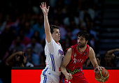 Milos Teodosic of Serbia drives against Thomas Heurtel of France during the 2014 FIBA World Basketball Championship semifinal match between France...