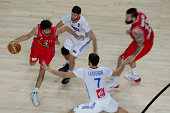 Milos Teodosic of Serbia drives forward Antoine Diot of France and his teammate Joffrey Lauvergne during the 2014 FIBA World Basketball Championship...