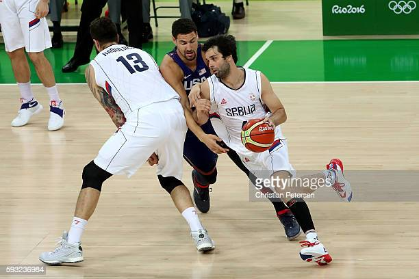 Milos Teodosic of Serbia drives the ball against the United States during the Men's Gold medal game on Day 16 of the Rio 2016 Olympic Games at...