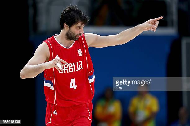 Milos Teodosic of Serbia reacts in the second half while taking on the United States in the Men's Preliminary Round Group A match on Day 7 of the Rio...