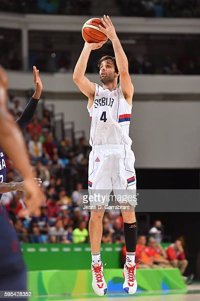 Milos Teodosic of Serbia shoots against the USA Basketball Men's National Team during the Gold Medal Game on Day 16 of the Rio 2016 Olympic Games on...
