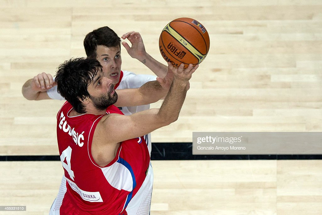 Milos Teodosic of Serbia shoots against Thomas Heurtel of France during the 2014 FIBA World Basketball Championship semifinal match between France...