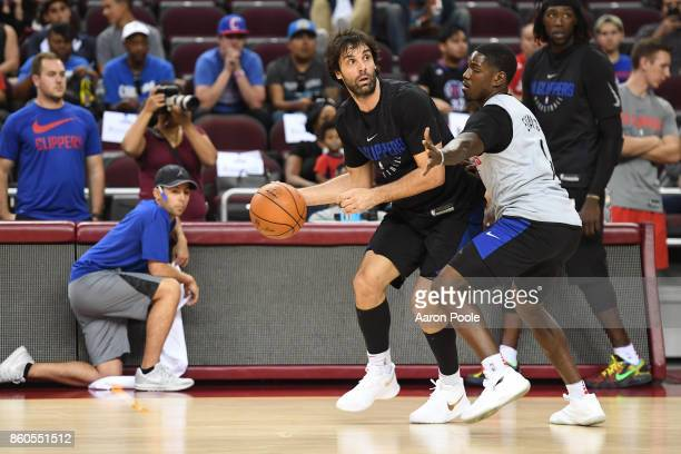 Milos Teodosic of the LA Clippers dribbles the ball at an open practice at the Galen Center on the campus of the University of Southern California on...