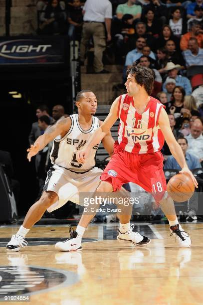 Milos Teodosic of the Greece Olympiacos drives the ball against Curtis Jerrells of the San Antonio Spurs during the exhibition game on October 9 2009...