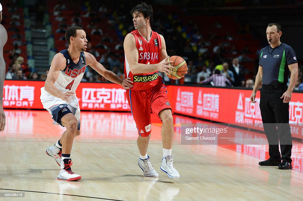 <a gi-track='captionPersonalityLinkClicked' href=/galleries/search?phrase=Milos+Teodosic&family=editorial&specificpeople=4453210 ng-click='$event.stopPropagation()'>Milos Teodosic</a> #4 of the Serbia National Team drives against <a gi-track='captionPersonalityLinkClicked' href=/galleries/search?phrase=Stephen+Curry+-+Jugador+de+baloncesto&family=editorial&specificpeople=5040623 ng-click='$event.stopPropagation()'>Stephen Curry</a> #4 of the USA Men's National Team during the 2014 FIBA World Cup Finals at Palacio de Deportes on September 14, 2014 in Madrid, Spain.