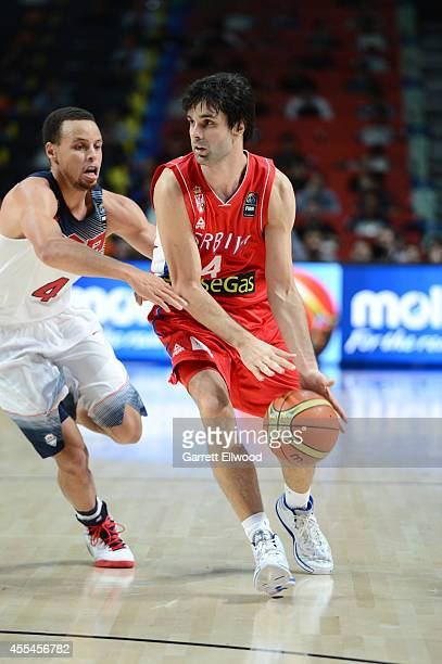 Milos Teodosic of the Serbia National Team drives against Stephen Curry of the USA Men's National Team during the 2014 FIBA World Cup Finals at...