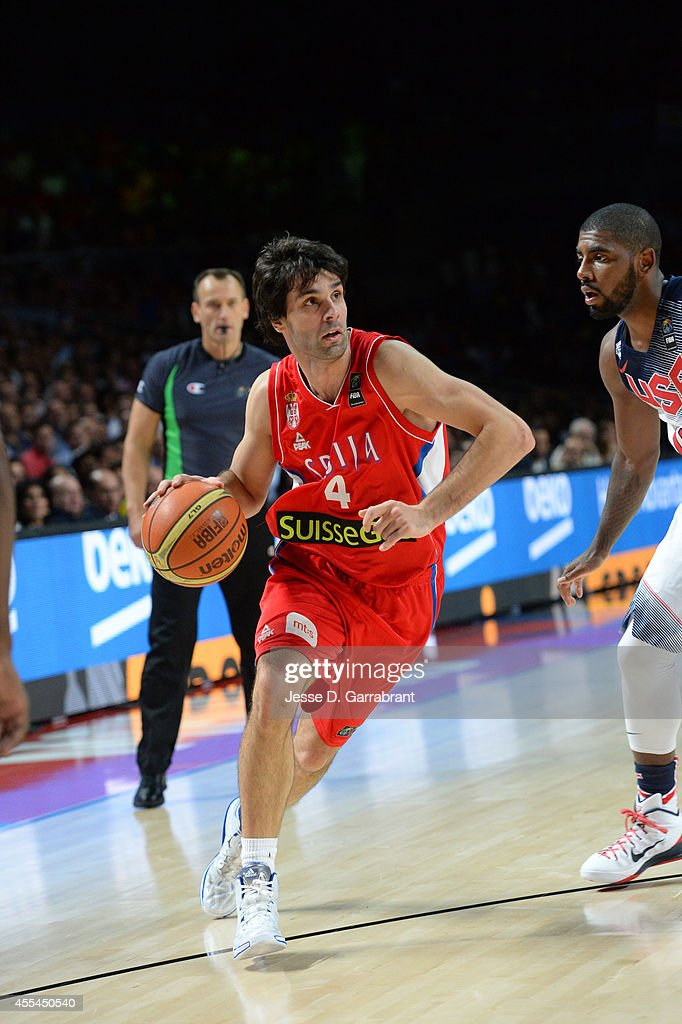 <a gi-track='captionPersonalityLinkClicked' href=/galleries/search?phrase=Milos+Teodosic&family=editorial&specificpeople=4453210 ng-click='$event.stopPropagation()'>Milos Teodosic</a> #4 of the Serbia National Team drives against the USA Men's National Team during the 2014 FIBA World Cup Finals at Palacio de Deportes on September 14, 2014 in Madrid, Spain.