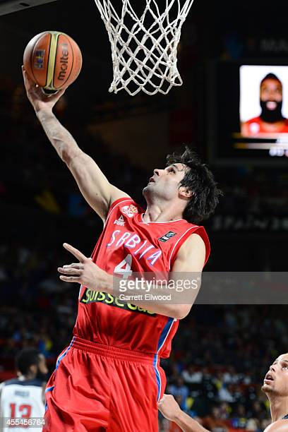 Milos Teodosic of the Serbia National Team drives against the USA Men's National Team during the 2014 FIBA World Cup Finals at Palacio de Deportes on...