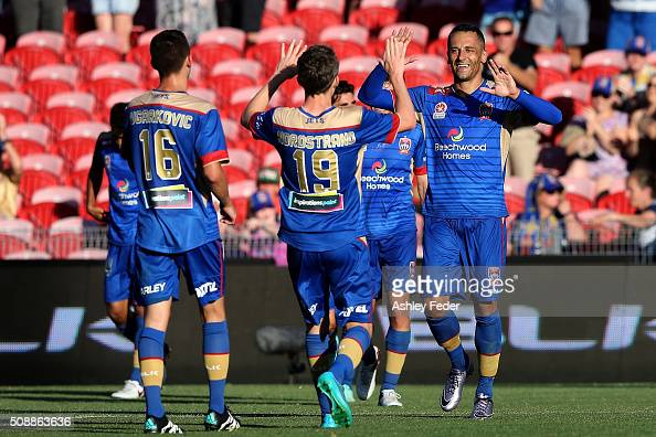 Milos Trifunovic of the Jets celebrates his goal with team mates during the round 18 ALeague match between the Newcastle Jets and Melbourne City FC...
