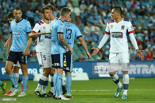 Milos Trifunovic of the Jets gestures to his team mate Ben Kantarovski of the Jets during the round nine ALeague match between Sydney FC and the...