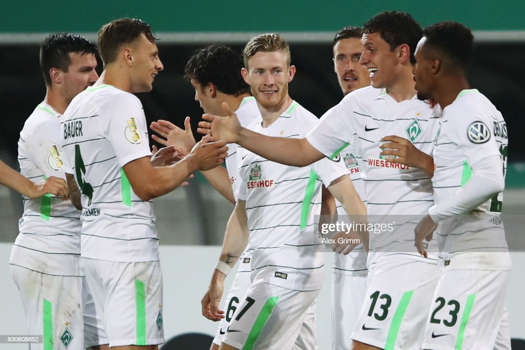 Milos Veljkovic of Bremen celebrates his team's first goal with team mates during the DFB Cup first round match between Wuerzburger Kickers and SV Werder Bremen at Sparda-Bank-Hessen-Stadion on August 12, 2017 in Offenbach, Germany.
