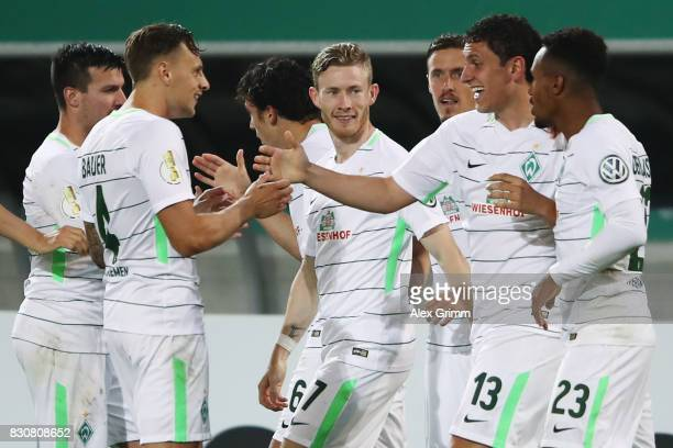 Milos Veljkovic of Bremen celebrates his team's first goal with team mates during the DFB Cup first round match between Wuerzburger Kickers and SV...