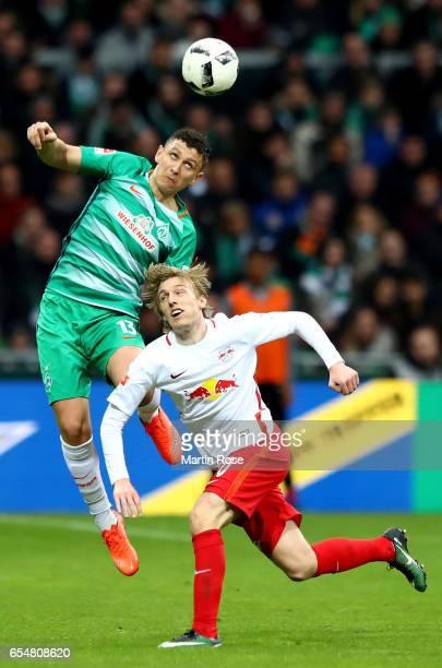 Milos Veljkovic of Bremen is challenged by Emil Forsberg of Leipzig during the Bundesliga match between Werder Bremen and RB Leipzig at Weserstadion...