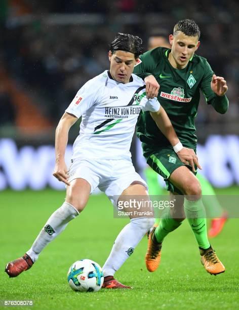 Milos Veljkovic of Bremen is challenged by Miiko Albornoz of Hannover during the Bundesliga match between SV Werder Bremen and Hannover 96 at...