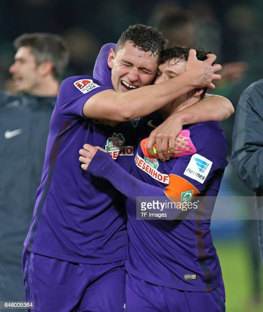 Milos Veljkovic of Werder Bremen and Zlatko Junuzovic of Werder Bremen celebrate their win after the Bundesliga match between VfL Wolfsburg and...