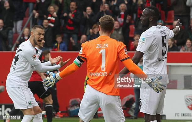 Milosevic Sjoestroem goalkeeper RonRobert Zieler and Salif Sane of Hannover 96 react after Ingolstadt scored the second goal during the Bundesliga...