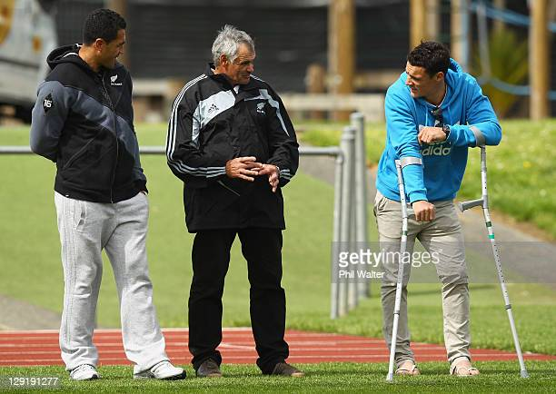 Mils Muliaina and Dan Carter listen to Dan's father Neville Carter during a New Zealand All Blacks IRB Rugby World Cup 2011 training session at...