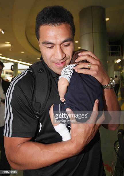 Mils Muliaina holds his new baby boy Max Muliaina after arriving at Auckland airport on December 2 2008 in Auckland New Zealand