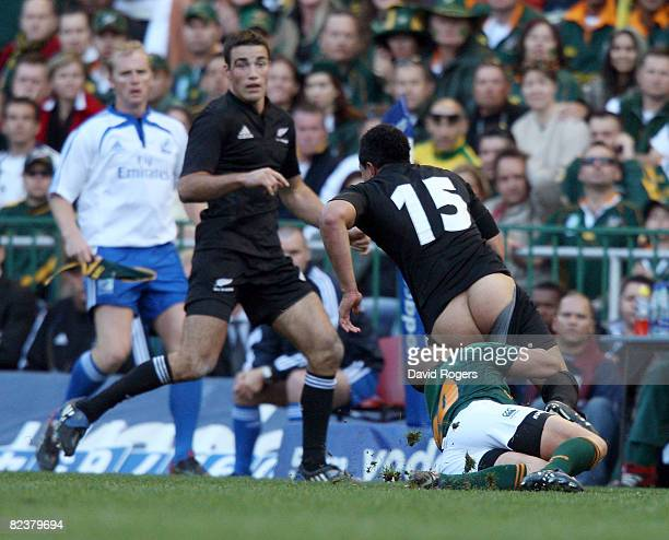 Mils Muliaina of the All Blacks as his shorts pull off by Ricky Januarie during the 2008 Tri Nations match between the South Africa Springboks and...