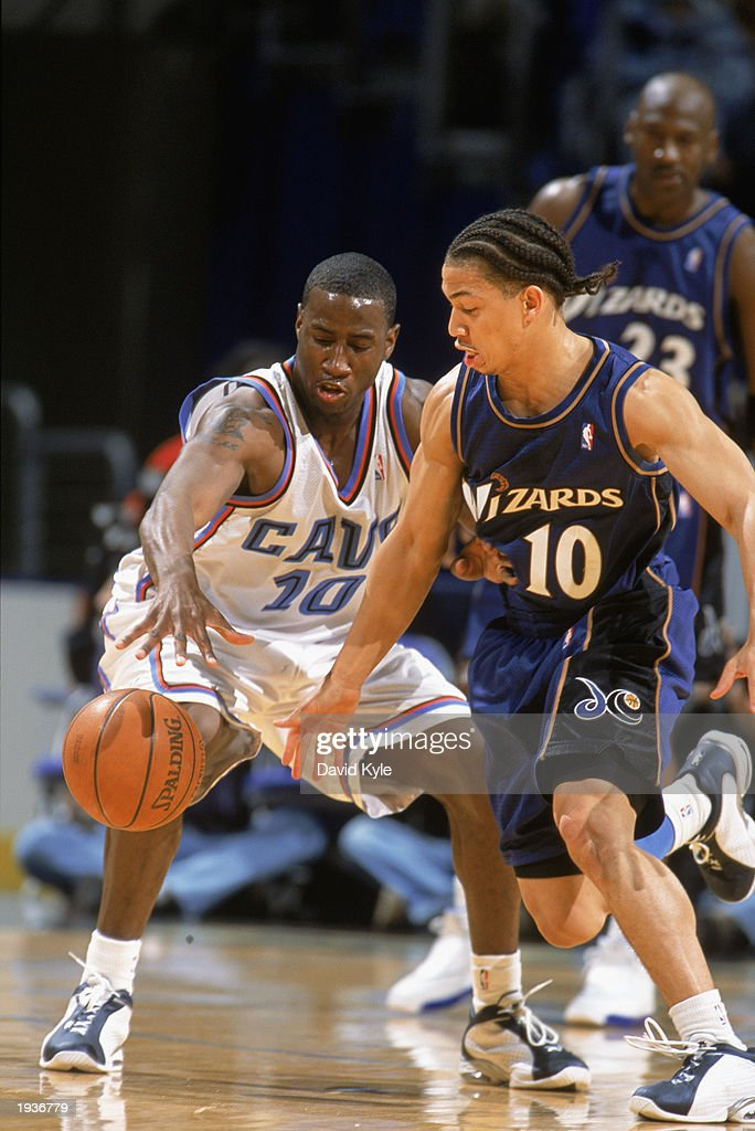 Milt Palacio #10 of the Cleveland Cavaliers is under pressure from Tyronn Lue #10 of the Washington Wizards during the game at Gund Arena on April 8, 2003 in Cleveland, Ohio. The Wizards defeated the Cavaliers 100-91.