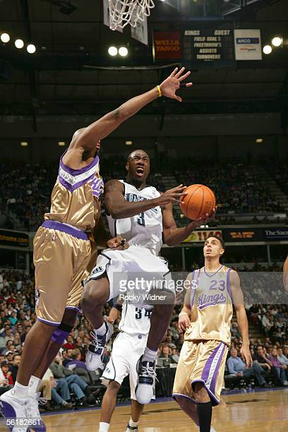 Milt Palacio of the Utah Jazz drives to the basket around Brian Skinner and Kevin Martin of the Sacramento Kings on November 15 2005 at ARCO Arena in...