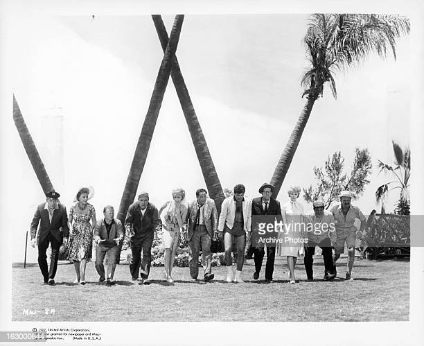 Milton Berle Ethel Merman Mickey Rooney Buddy Hackett Sid Caesar Phil Silvers and the rest all walk in search of the money in a scene from the film...