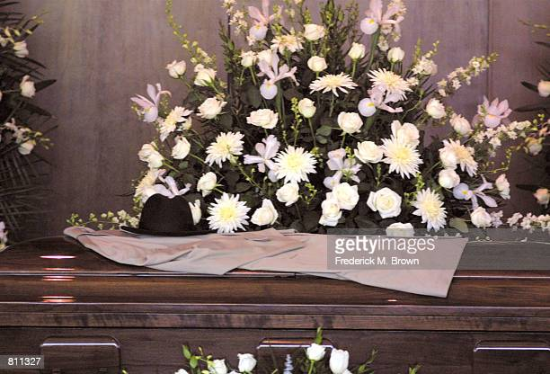 Milton Berle's trademark coat and hat are laid on top of his coffin during the funeral for the late comedian at Hillside Memorial Park April 1 2002...