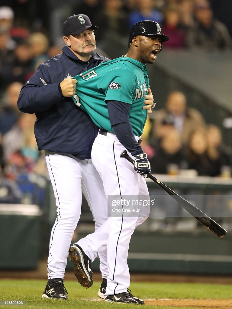 Milton Bradley #15 of the Seattle Mariners is restrained by manager <a gi-track='captionPersonalityLinkClicked' href=/galleries/search?phrase=Eric+Wedge&family=editorial&specificpeople=214257 ng-click='$event.stopPropagation()'>Eric Wedge</a> #22 after being ejected from the game against the Chicago White Sox at Safeco Field on May 6, 2011 in Seattle, Washington.