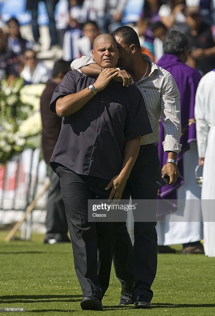 Milton Calero gives his brother a last goodbye to the ex-Pachuca goalkeeper during the funeral mass of Miguel Calero in Huracan Stadium on December 6, 2012 in Pachuca, Mexico.