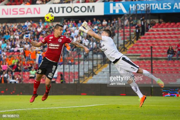 Milton Caraglio of Tijuana and Tiago Volpi of Queretaro fight for the ball during the 10th round match between Queretaro and Tijuana as part of the...
