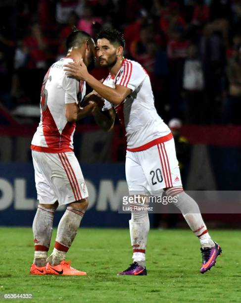Milton Casco and Ariel Rojas of River Plate celebrate after winning a group stage match between Deporivo Independiente Medellin and River Plate as...
