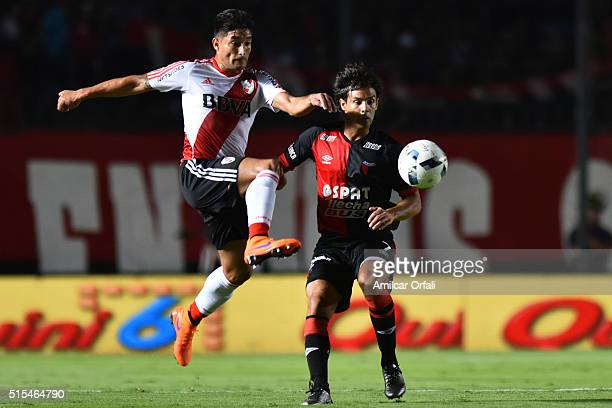 Milton Casco of River Plate and Diego Lagos of Colon fight for the ball during a match between Colon and River Plate as part of Torneo de Transicion...