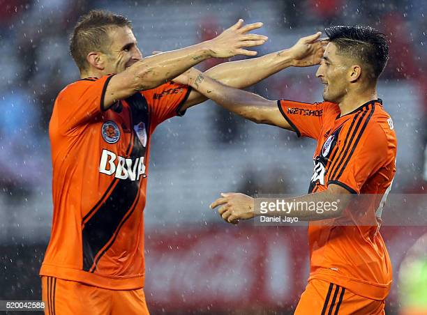 Milton Casco of River Plate celebrates with teammate Ivan Alonso after scoring during a match between River Plate and Sarmiento as part of Torneo...