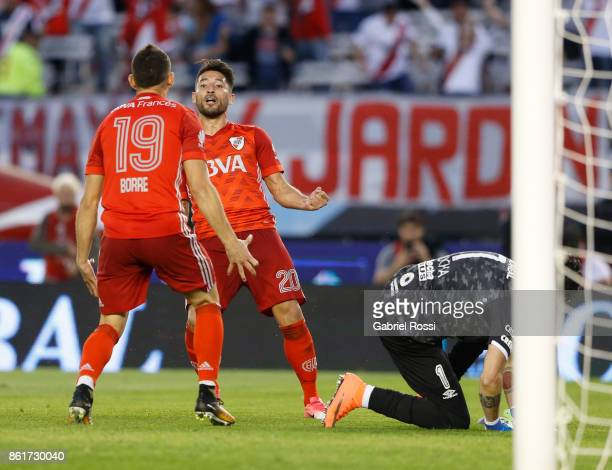 Milton Casco of River Plate celebrates with teammate Rafael Santos Borre after scoring the first goal of his team during a match between River Plate...