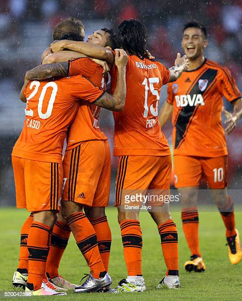 Milton Casco of River Plate celebrates with teammates after scoring the second goal of his team during a match between River Plate and Sarmiento as...