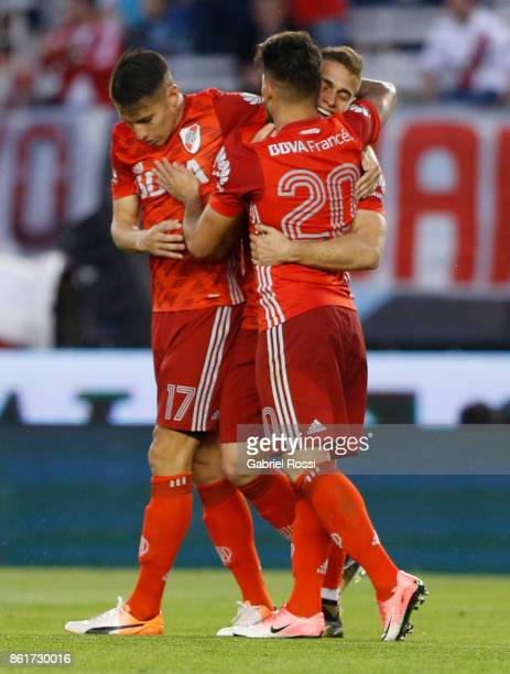 Milton Casco of River Plate celebrates with teammates after scoring the first goal of his team during a match between River Plate and Atletico de...