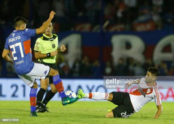 Milton Casco of River Plate fights for the ball with Agustin Cardozo of Tigre during a match between Tigre and River Plate as part of Torneo Primera...