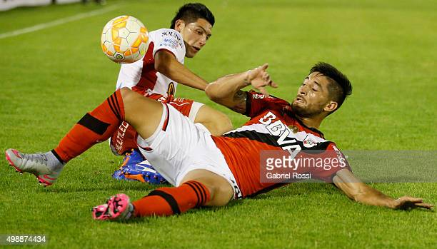 Milton Casco of River Plate fights for the ball with Cristian Espinoza of Huracan during a second leg match between Huracan and River Plate as part...