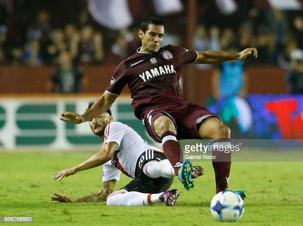 Milton Casco of River Plate fights for the ball with Jose Sand of Lanus nduring a match between Lanus and River Plate as part of Torneo Primera...