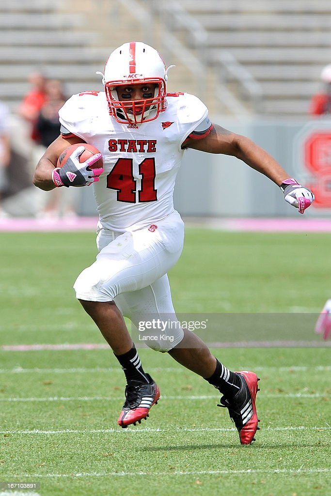 Milton Hall #41 of the North Carolina State Wolfpack runs with the ball during the Kay Yow Spring Football Game at Carter-Finley Stadium on April 20, 2013 in Raleigh, North Carolina.