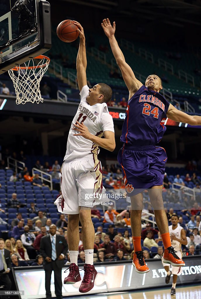 Milton Jennings #24 of the Clemson Tigers blocks Kiel Turpin #11 of the Florida State Seminoles from behind during the first round of the Men's ACC Basketball Tournament at Greensboro Coliseum on March 14, 2013 in Greensboro, North Carolina.