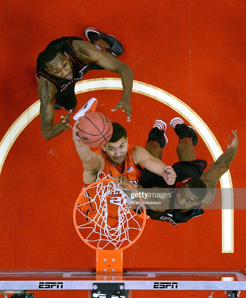 Milton Jennings #24 of the Clemson Tigers drives to the basket between defenders <a gi-track='captionPersonalityLinkClicked' href=/galleries/search?phrase=C.J.+Leslie&family=editorial&specificpeople=6902920 ng-click='$event.stopPropagation()'>C.J. Leslie</a> #5 and <a gi-track='captionPersonalityLinkClicked' href=/galleries/search?phrase=Richard+Howell&family=editorial&specificpeople=2313901 ng-click='$event.stopPropagation()'>Richard Howell</a> #1 of the North Carolina State Wolfpack during play at PNC Arena on January 20, 2013 in Raleigh, North Carolina. North Carolina State won 66-62.