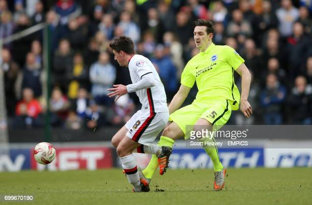 Milton Keynes Dons' Darren Potter and Brighton and Hove Albion's Lewis Dunk