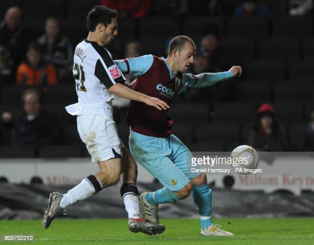 Milton Keynes Dons' Luke Howell and Burnley's Steven Fletcher battle for the ball during the FA Cup Third Round match at The StadiumMK Milton Keynes