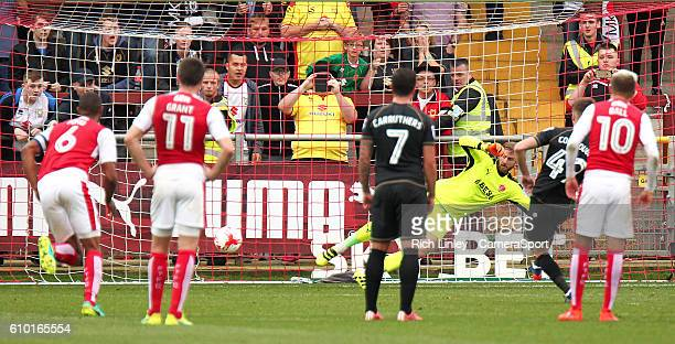 FLEETWOOD ENGLAND SEPTEMBER Milton Keynes Dons' Ryan Colclough scores his sides fourth goal from the penalty spot during the Sky Bet League One match...